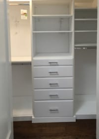 Ridgewood Closets white reach in closet with drawers